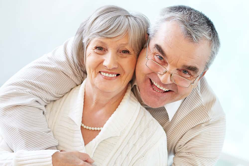 smiling senior couple with great teeth - photo credit freepik